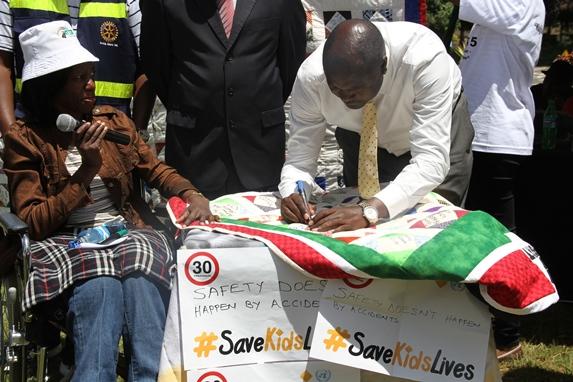 NTSA Director General, Francis Mejja signing ASIRT Kenya memorial quilt
